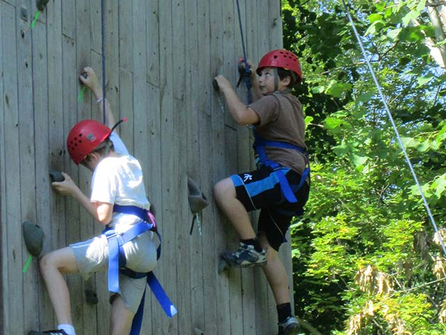 Hiram House campers climbing a wall