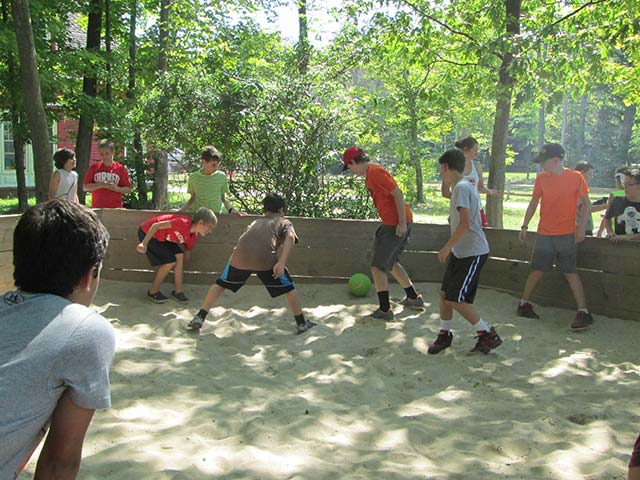 Hiram House campers playing soccer