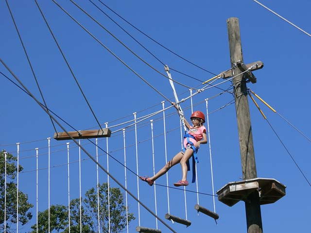 Summer camp student swinging at Hiram House Camp